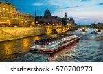 bateau mouche cruising on seine ... | Shutterstock . vector #570700273