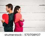 angry couple holding broken... | Shutterstock . vector #570708937