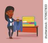 young happy woman packing... | Shutterstock .eps vector #570827833