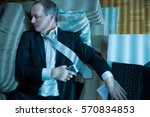 businessman in suit lying on a...   Shutterstock . vector #570834853