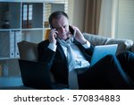 businessman in suit lying on a...   Shutterstock . vector #570834883