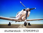 sports plane on the runway | Shutterstock . vector #570939913