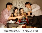 couples sitting down with wine... | Shutterstock . vector #570961123