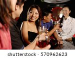 men and women at bar  drinking | Shutterstock . vector #570962623
