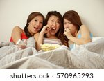 young women lying on bed side... | Shutterstock . vector #570965293