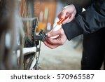 young man hand repairing his... | Shutterstock . vector #570965587