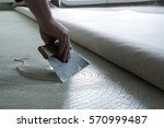 Small photo of Floor Fitter when applying adhesive on the floor