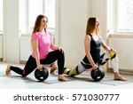 two young sporty female doing  ... | Shutterstock . vector #571030777