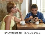 young american couple at coffee ... | Shutterstock . vector #571061413