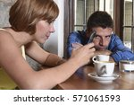 young american couple at coffee ... | Shutterstock . vector #571061593