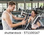 trainer yelling through a... | Shutterstock . vector #571100167