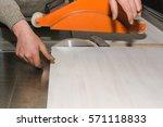 men at work sawing wood.... | Shutterstock . vector #571118833