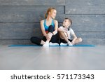 fitness mother with her 9 years ... | Shutterstock . vector #571173343