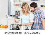 smiling young couple cooking... | Shutterstock . vector #571220257
