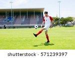athlete juggling the football... | Shutterstock . vector #571239397