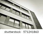 facade of a modern apartment... | Shutterstock . vector #571241863
