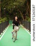 Pretty Thai Girl Rides Bicycle...
