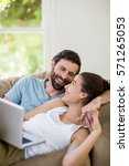 happy couple lying on sofa and...   Shutterstock . vector #571265053