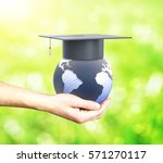 hand holding globe with... | Shutterstock . vector #571270117