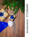 christmas tree branch gifts on... | Shutterstock . vector #571286683