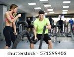 female personal trainer... | Shutterstock . vector #571299403