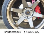 wheel closeup with brake disc... | Shutterstock . vector #571302127