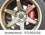 wheel closeup with brake disc... | Shutterstock . vector #571302133