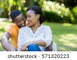 happy couple posing together at ... | Shutterstock . vector #571320223