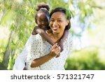 happy family having fun at park | Shutterstock . vector #571321747