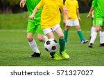 running football soccer players ... | Shutterstock . vector #571327027