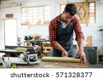 carpenter working on his craft... | Shutterstock . vector #571328377