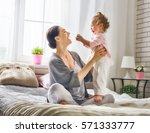 happy loving family. young... | Shutterstock . vector #571333777
