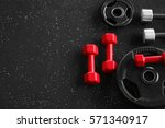 weight plates and dumbbells on... | Shutterstock . vector #571340917