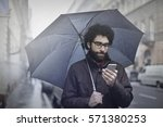 guy in jacket holding his... | Shutterstock . vector #571380253