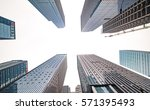 looking up at business buildings | Shutterstock . vector #571395493