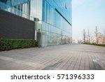 windows of skyscraper business... | Shutterstock . vector #571396333
