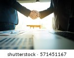 business partnership meeting... | Shutterstock . vector #571451167
