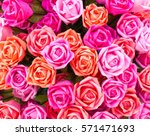 Stock photo a bouquet of pink roses made of colored paper 571471693
