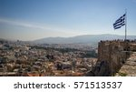 Small photo of View over Athens, Greece form Acropolis on a summer day. Greek flag is seen in the corner