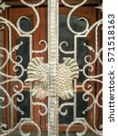 Small photo of Vintage old metal door, entrance way. Alloy steel gate cover wooden door. Retro and classic design with plant pattern.