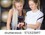 female workout friends using...   Shutterstock . vector #571525897