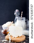 Small photo of Fresh dairy products milk, cottage cheese Adygei cheese on a dark stone background