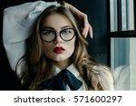 indoor close up portrait of... | Shutterstock . vector #571600297