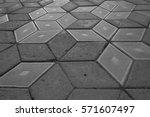 gray plates of street pavement... | Shutterstock . vector #571607497