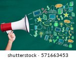 hand holding megaphone with... | Shutterstock . vector #571663453