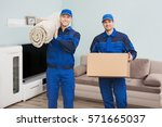portrait of a two male movers... | Shutterstock . vector #571665037