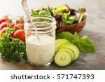 homemade ranch dressing in a... | Shutterstock . vector #571747393