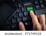 Small photo of business concept shows the smartphone as well as the fingers that press ACTIVATE on the keyboard