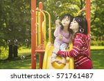 photo of a beautiful mother and ... | Shutterstock . vector #571761487