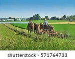 Small photo of Amish farmer working in the field in Lancaster, PA. June 20, 2016